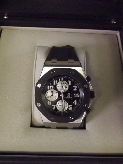 A Gentleman's Audemars Piguet chronograph wristwatch, a