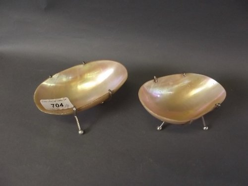 A pair of shell salts with silver plated mounts, 4¾'' x