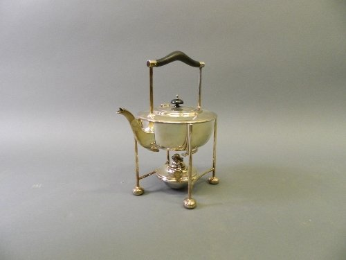 An Arts & Crafts silver plated spirit kettle on stand,