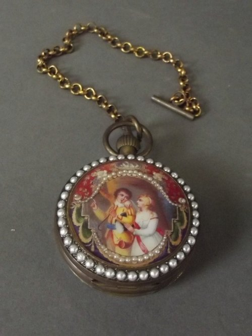 An Omega pocket watch decorated with enamel plaques