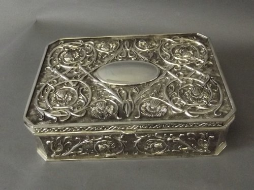 A silver plated jewellery box with fitted inside and