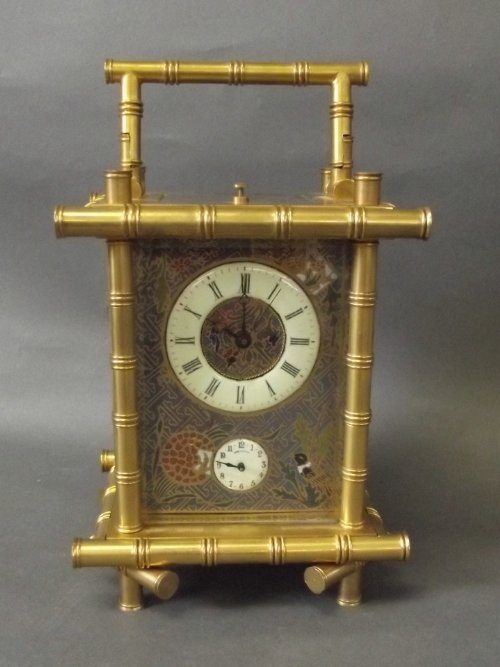 A large brass repeater carriage clock with cloisonné