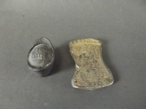 A silvered metal Chinese boat and ingot with character