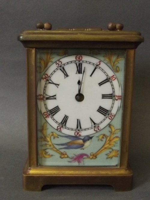 A C19th brass carriage clock with ceramic panels