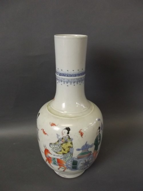 A Chinese long neck vase decorated with a deer pulling