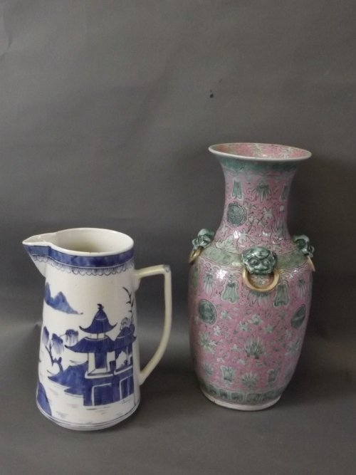 A pink ground Chinese vase with applied dog's head