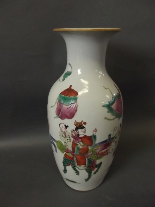 A Chinese vase decorated with a family riding a kylin