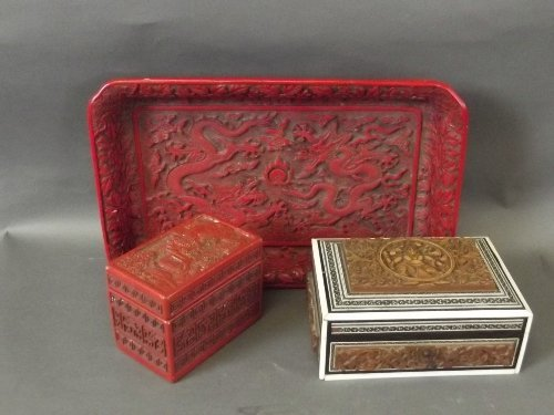 A cinnabar lacquer style tray carved with dragons