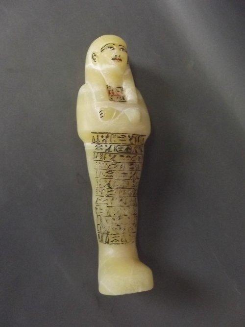 A good alabaster shabti decorated with hieroglyphics,