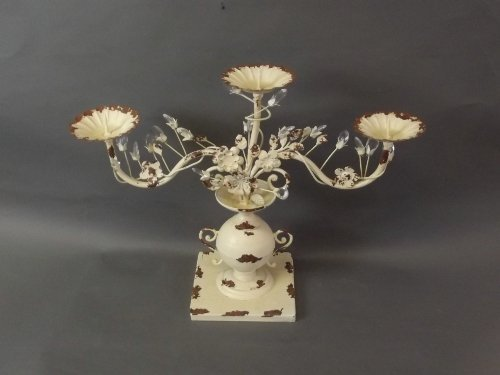 A three branch table candelabrum decorated with