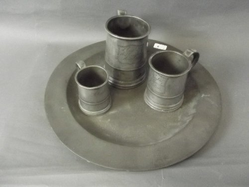 A large antique pewter charger and 3 Victorian pewter