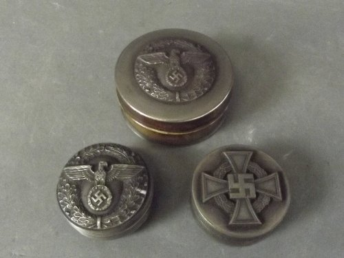 A collection of bronze snuff boxes with German military