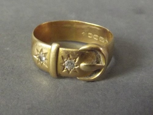 A Hallmarked 18ct gold buckle ring with 2 inset stones,