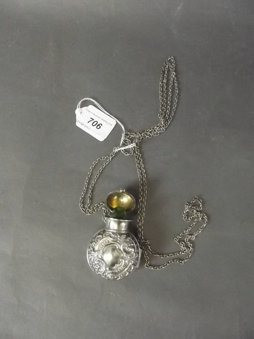 A Hallmarked silver cased coloured glass scent bottle