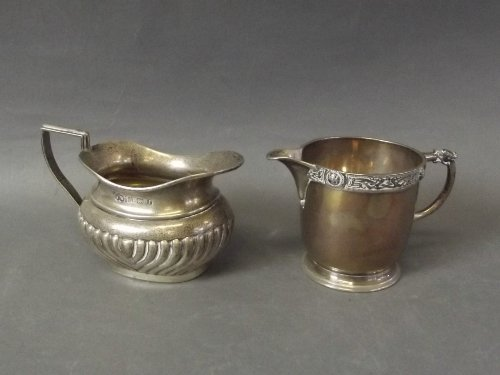 Two Hallmarked silver cream jugs, London 1937/38, and