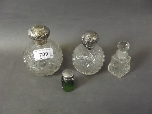 Two Victorian silver topped cut glass scent bottles,