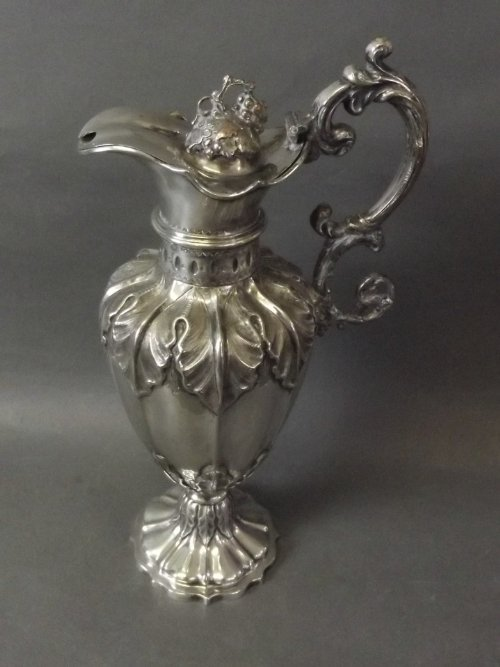A late Victorian silver plated pedestal wine jug emboss