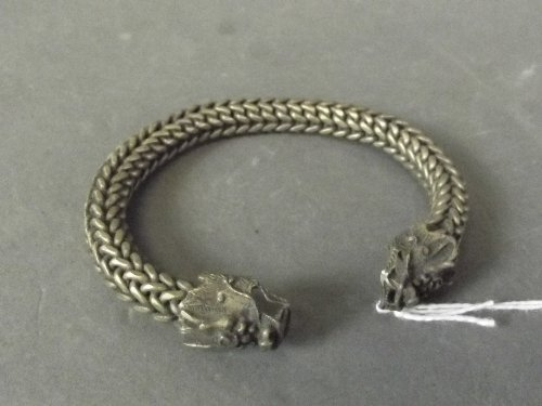 A Chinese white metal rope bracelet with dragon heads