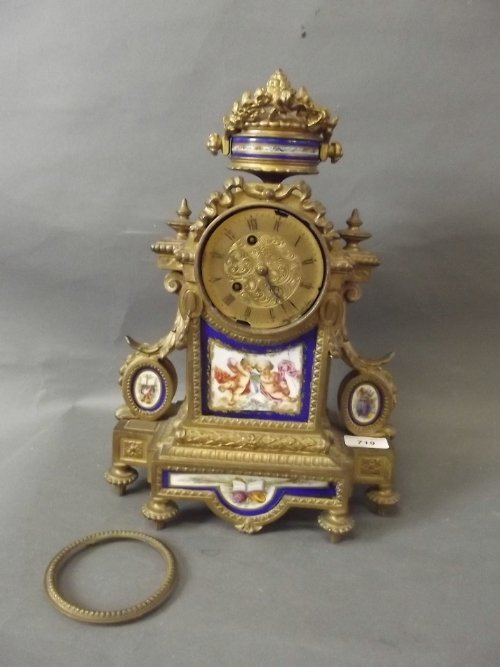 A C19th French gilt spelter and porcelain mounted