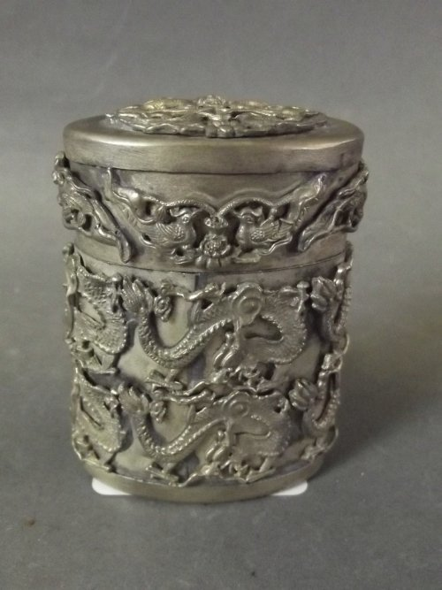 A Chinese white metal pot and lid decorated with