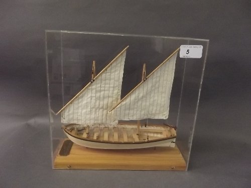 A hand made model of the 2 masted longboat H.M.S. Ajax