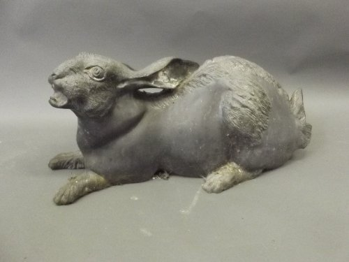 A large weathered bronze model of a hare, 22'' wide