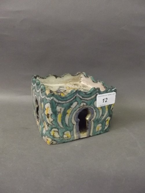 A C19th Islamic pottery square form scribes stand, hand