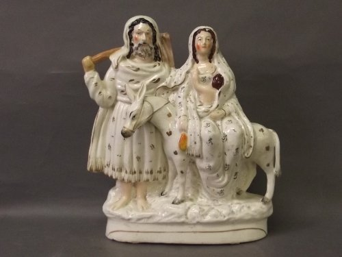A Staffordshire white and gilt group of Flight to Egypt