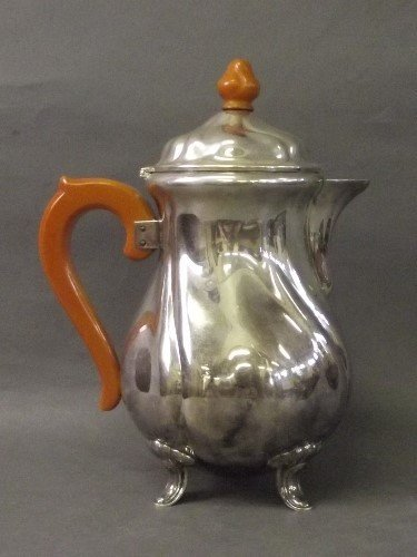 A silver plated coffee pot with a bakerlite handle and