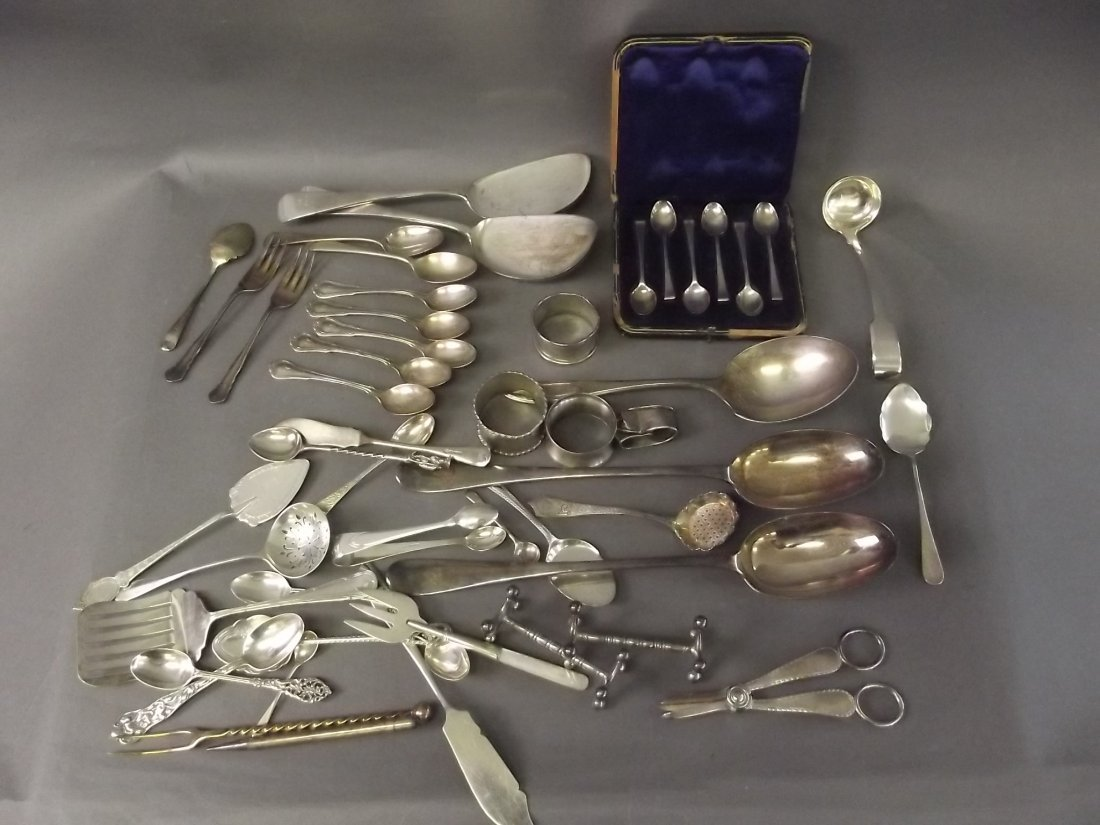 A collection of silver plated spoons and a quantity of