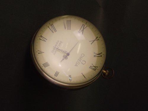 An Omega brass bound glass orb desk clock, 4¼''
