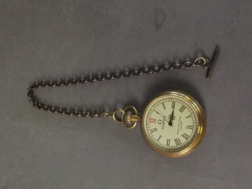 A brass Omega pocket watch and chain, watch 2''