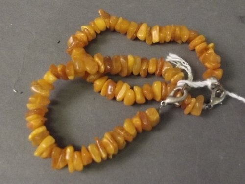 A pair of amber style bracelets, 6½'' long