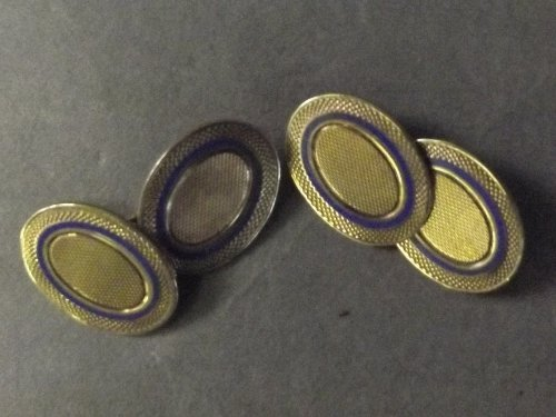 A pair of 9ct gold cufflinks with blue enamel