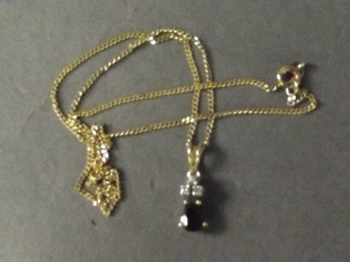A small ruby and diamond pendant on 18ct gold chain