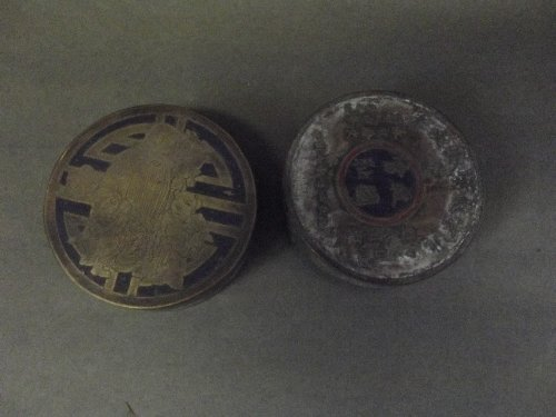 Two Chinese bronze ink boxes decorated with family