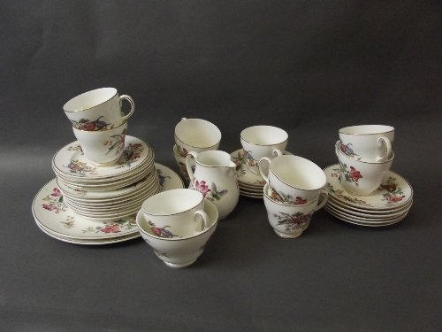 A Wedgwood bone china part service decorated with