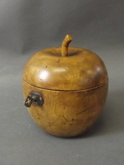 A treen tea caddy in the form of an apple, 4¾'' high