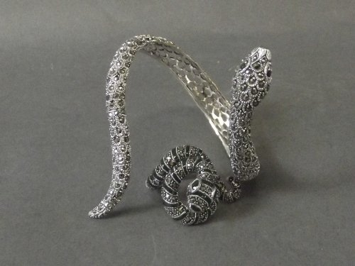 A silver and marcasite set snake bangle and ring set