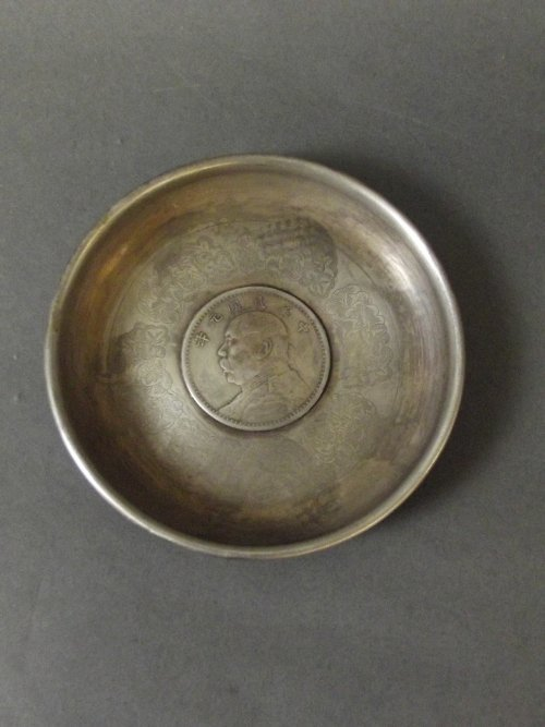 A Chinese white metal dish with engraved decoration and