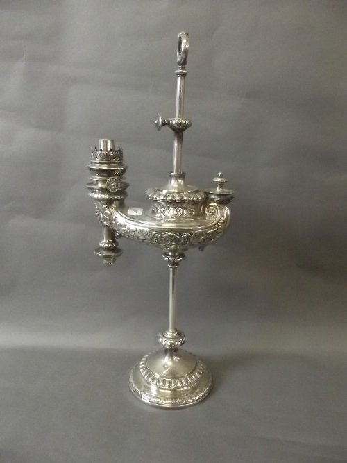 A good C19th silver plated adjustable oil lamp in the