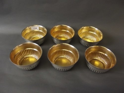 A set of 6 WMF silver plate and gilt half fluted bowls,