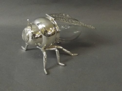 A silver plate and glass honey pot in the form of a