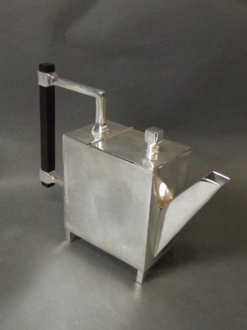 A Christopher Dresser style teapot, 8'' long