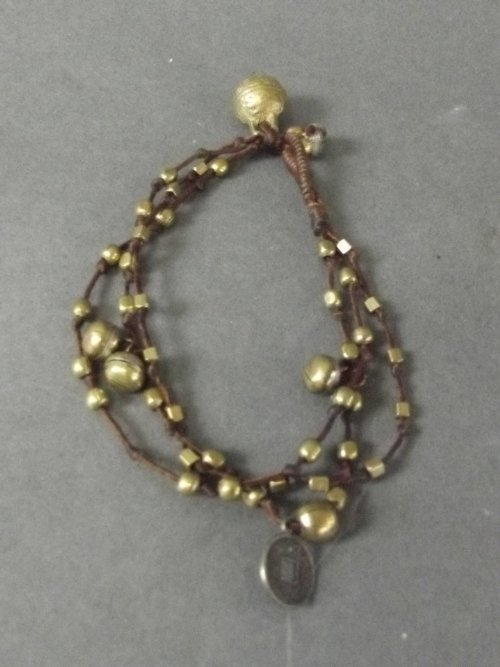 A Chinese gold metal and twine bracelet decorated with