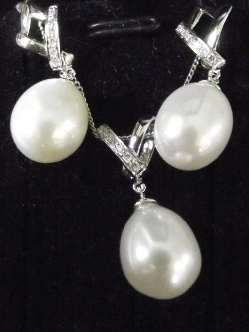 A pair of 18ct white gold, diamond and pearl earrings