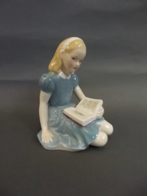 A Royal Doulton seated figure 'Alice' HN 2158, 4½''