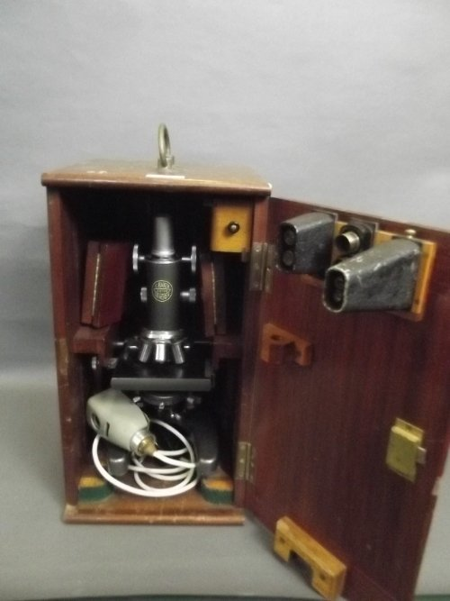 A microscope by C. Baker, in a fitted mahogany case,