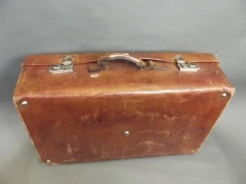 An early C20th elephant skin suitcase with chrome