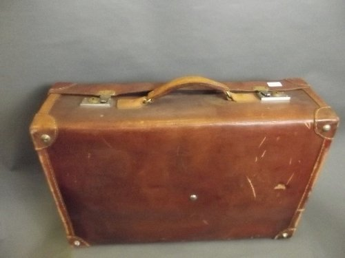 A large vintage leather suitcase, 29'' x 19''